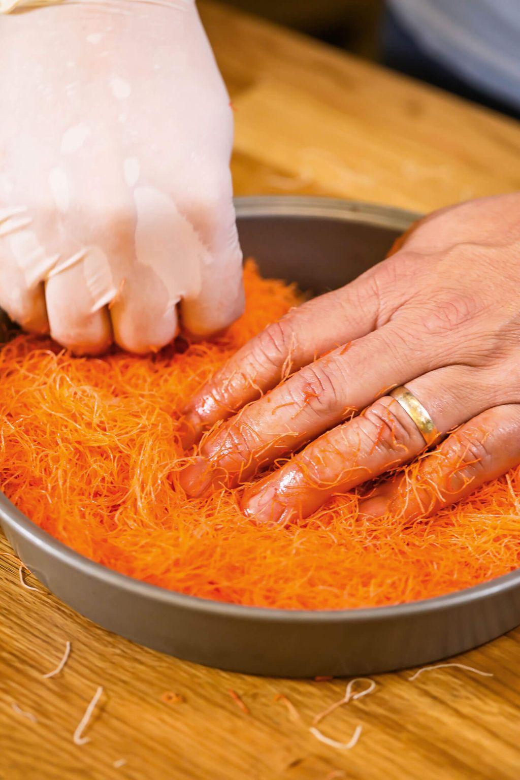 pressing down dough